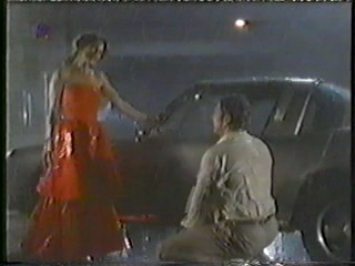 German movie - long red dress in rain
