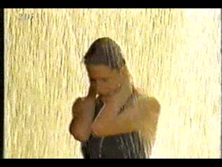 German movie - black dress in fountain