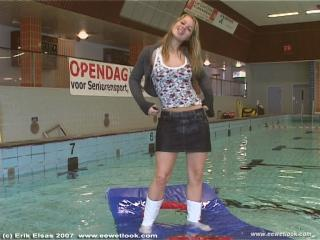 EE Wetlook, sample of Niki in skirt and boots in pool