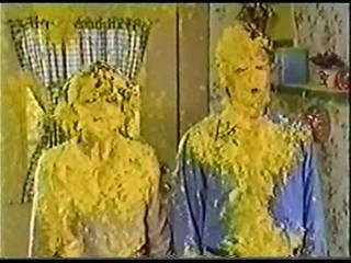 A Man & Women get Covered in Yellow Gunge