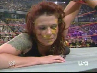 wwe:- Lita sprayed in the face with mustard