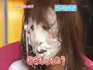 Japanese pop idols pied in the face