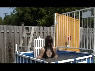 Violet dunked in a black bikini