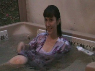 Jennifer in the hottub in her nightgown